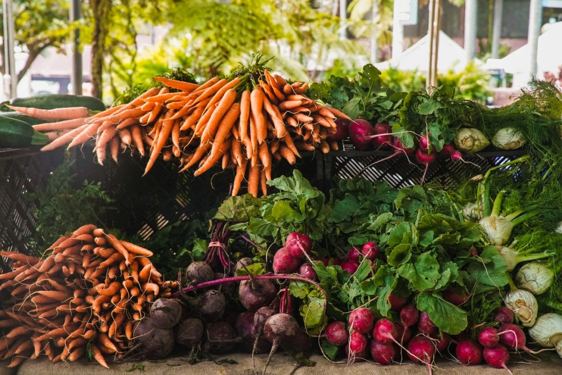 piles of carrots, beets, and raddishes