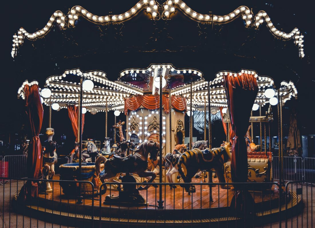 small carousel lit up at night