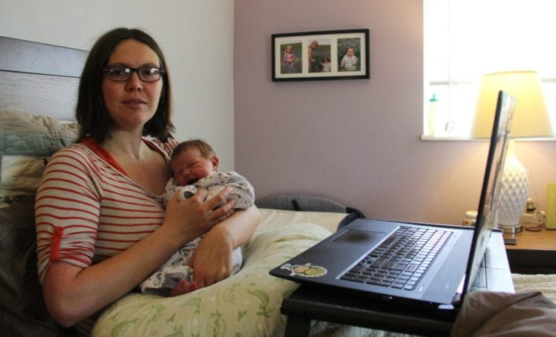 working from bed with a newborn